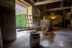 Chateau du Clos de Vougeot. Old casks of a winery and cart. Cote de Nuits, Burgundy, France. VOUGEOT, FRANCE: Chateau du Clos de Vougeot courtyard. Clos de royalty free stock images