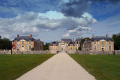 Chateau in france. French chateau with long entrance driveway and dramatic sky Stock Photo