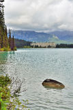 The Chateau Lake Louise hotel as seen from the trail in Canadian Rockies during a cloudy day Royalty Free Stock Image