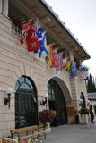 Chateau Lake Louise. Hotel with flags of the Canadian provinces Stock Image