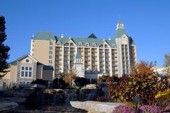 Chateau on the Lake Resort. Beautiful Chateau on the Lake Resort stands tall against a blue sky.  Rocks and waterfall stand in front Royalty Free Stock Photo