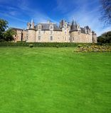 Chateau and lawn Stock Images
