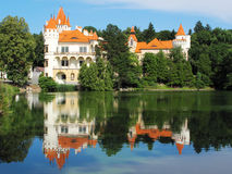 Chateau mirroring in a lake. Romantic chateau Zinkovy in West Bohemia, European union. Castle was founded in year 1176. Later was rebuild as chateau in 17th stock image