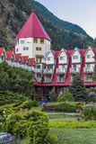 Chateau by the Mountains. Corner of chateau by the garden in Revelstoke Royalty Free Stock Image