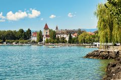Chateau Ouchy at Lake Geneva promenade summer Lausanne. Lausanne, Switzerland - August 26, 2018: Chateau Ouchy at Lake Geneva promenade, Lausanne, Switzerland royalty free stock image