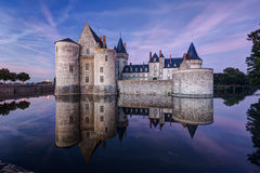 The chateau of Sully-sur-Loire at night, France. This castle is located in the Loire Valley, dates from the 14th century and is a prime example of medieval Stock Photos
