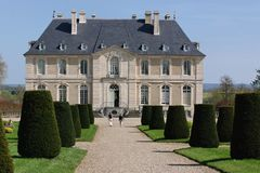 Chateau Vendeuvre. Two people walking along path toward French Normandy chateau stock photos