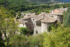 The Chateau of Vogue on the banks of the Ardeche in France. Dominating a village classified among the most picturesque in France, on the banks of the Ardeche Stock Images