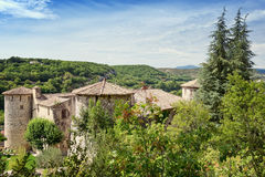 The Chateau of Vogue on the banks of the Ardeche in France. Dominating a village classified among the most picturesque in France, on the banks of the Ardeche Stock Photos