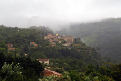Chateaudouble above the mist covered forests of the Var. The historic and Beautiful French mountain village of Chateaudouble perched above the mist covered Royalty Free Stock Photo