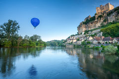 Chateaux Beynac and a hot air baloon Royalty Free Stock Photos