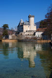 Chateaux de Duingt reflected in water Stock Photo