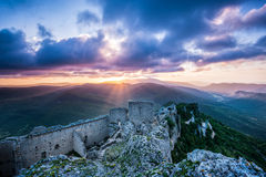 Chateau Peyrepertuse at sunrise Languedoc France stock photo
