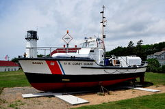Chatham, MA: Coast Guard Cutter at Chatham Light. Chatham, Massachusetts:  U. S. Coast Guard Cutter #44301 and Chatham Lighthouse Royalty Free Stock Image