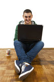 Chating with friends online. Young male sitting with laptop, chating online with friends Royalty Free Stock Images
