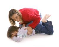 Chatouillement de maman image libre de droits
