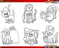 Chats sur livre de coloriage réglé de temps de Noël Photos stock