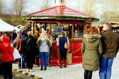 Winter Warmers. Chatsworth, Derbyshire, UK. November 22, 2017. Visitors queue for Winter warmers on a cold November day at the Christmas market at Chatsworth in stock images