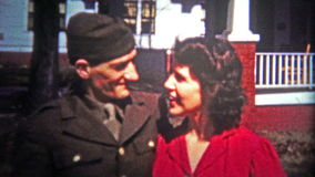 CHATTANOOGA, USA - 1955: Military war hero reunites with his sweetheart after his tour of duty. Unique vintage 8mm film home movie professionally cleaned and stock footage