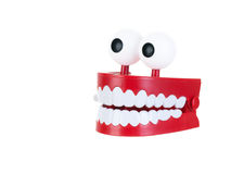 Chattering teeth. On a pure white background Stock Photos