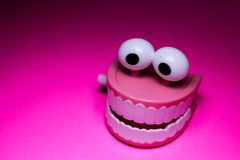 Chattering teeth plastic wind up toy royalty free stock photo