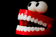 Chattering teeth toy from three quarter with open mouth stock images
