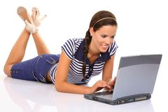 Chatting. Young beautiful woman with laptop on white background Stock Photos