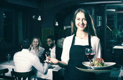 Chatting adults and cheerful waitress. Portrait of chatting adults in restaurant and cheerful waitress Stock Photos