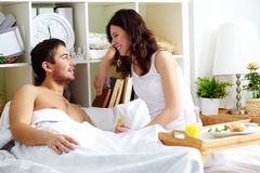 Chatting in bed Royalty Free Stock Images