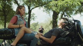 Young cute couple travelers relaixing on motorbike stock video footage