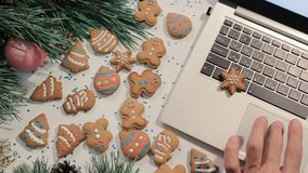 Chatting during Christmas and New Year holidays. Unrecognizable man typing on laptop using touch pad stock footage