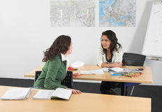 Chatting in class Royalty Free Stock Images