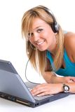Chatting is cool. Beautiful smiling teenage girl with a laptop and headphones, on white background Stock Images