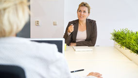 Chatting coworkers Stock Image