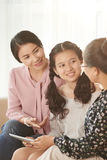 Chatting family. Female generation of Vietnamese family chatting at home royalty free stock image