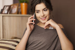 Chatting with friend on the phone Stock Photography