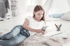 Gleeful girl chatting on her phone royalty free stock photo