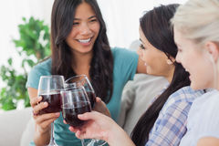Chatting friends having red wine together. At home on couch Stock Image