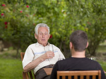 Chatting in garden Stock Images