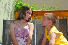 Chatting girl and boy Stock Image
