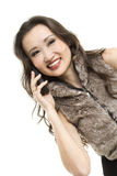 Chatting on a mobile phone. A beautiful young woman talking on a mobile phone Royalty Free Stock Photography