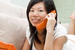 Chatting phone. Asian woman on sofa chatting phone Stock Photos