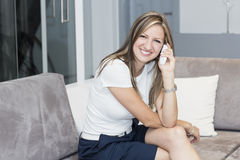 Chatting by phone Royalty Free Stock Image