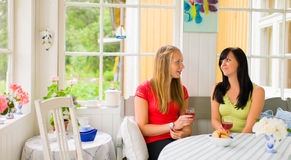 Chatting in porch Stock Images