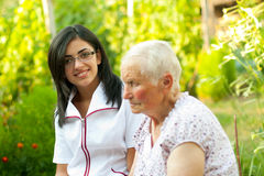 Chatting with sick elderly woman Stock Photo