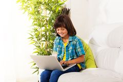 Chatting on social network on laptop Stock Image