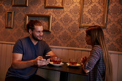 Chatting young couple in a pub Royalty Free Stock Photography
