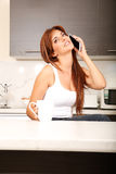 Chatty in the kitchen Royalty Free Stock Photos