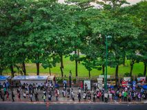 Chatuchak park, Bangkok,Thailand: People wait for bus at bus stop in front of Chatuchak park. Stock Photo