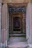 Chau say tevoda. Lintel and columns with bas-reliefs inside the prasat of the temple of chau say tevoda in siam reap, cambodia Stock Photography